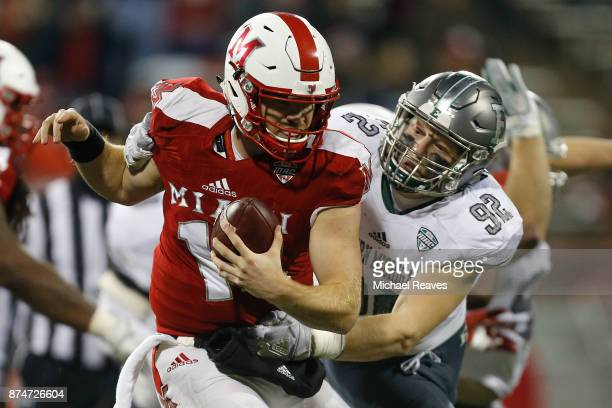 Maxx Crosby of the Eastern Michigan Eagles sacks Gus Ragland of the Miami Ohio Redhawks during the second half at Yager Stadium on November 15 2017...