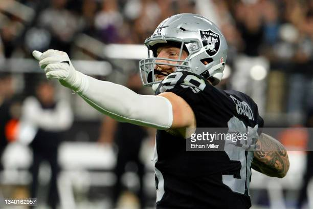 Maxx Crosby of the Las Vegas Raiders celebrates after a sack against Lamar Jackson of the Baltimore Ravens in the third quarter at Allegiant Stadium...
