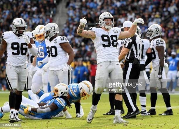 Maxx Crosby of the Oakland Raiders celebrates his stop of Melvin Gordon of the Los Angeles Chargers during the second quarter at Dignity Health...