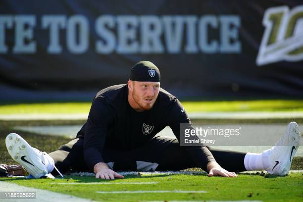Maxx Crosby of the Oakland Raiders warms up prior to the game against the Cincinnati Bengals at RingCentral Coliseum on November 17, 2019 in Oakland,...