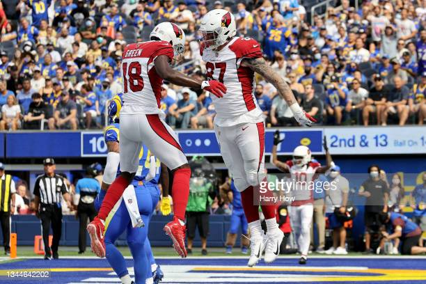 Maxx Williams and A.J. Green of the Arizona Cardinals celebrate Williams' second quarter touchdown catch against the Los Angeles Rams at SoFi Stadium...