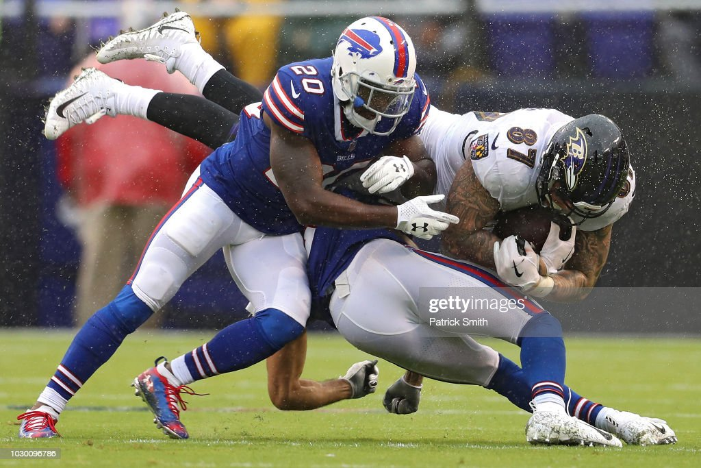 Maxx Williams #87 of the Baltimore Ravens is tackled by Rafael Bush #20 of the Buffalo Bills in the second quarter at M&T Bank Stadium on September 9, 2018 in Baltimore, Maryland.