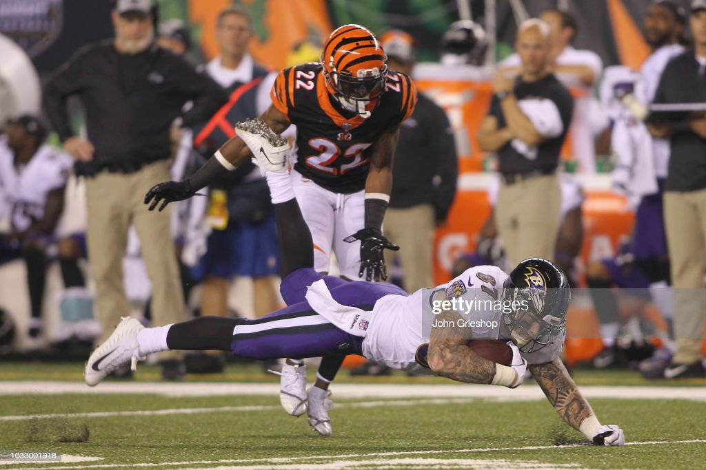 Maxx Williams #87 of the Baltimore Ravens runs the football upfield against William Jackson #22 of the Cincinnati Bengals during their game at Paul Brown Stadium on September 13, 2018 in Cincinnati, Ohio. The Bengals defeated the Ravens 34-23.