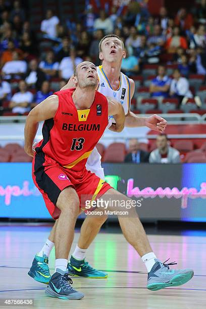 Maxym Korniyenko of Ukraine competes with PierreAntoine Gillet of Belgium during the FIBA EuroBasket 2015 Group D basketball match between Ukraine...