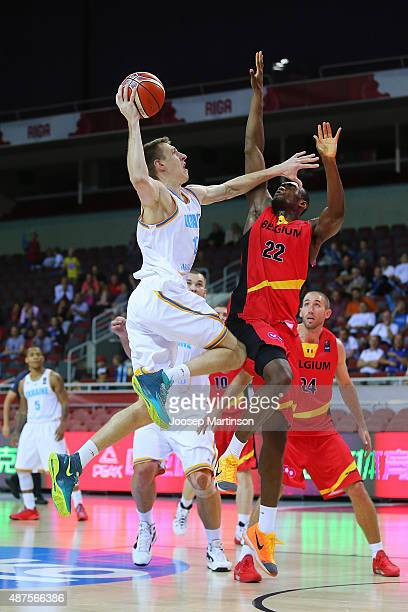 Maxym Korniyenko of Ukraine goes for the basket against Kevin Tumba Charleroi of Belgium during the FIBA EuroBasket 2015 Group D basketball match...
