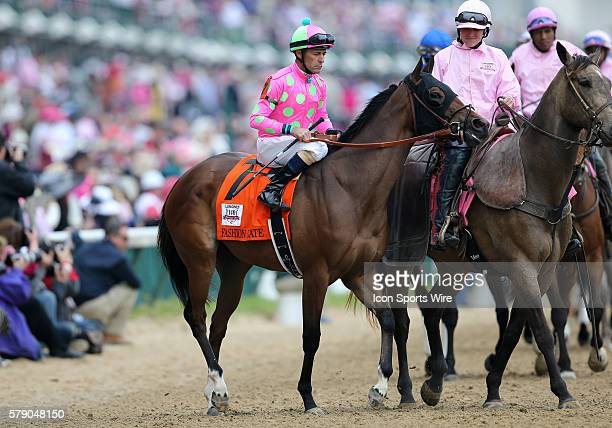 Jockey Gary Stevens rides Please Explain during the Post Parade at the 140th running of the Kentucky Oaks at Churchill Downs in Louisville Kentucky