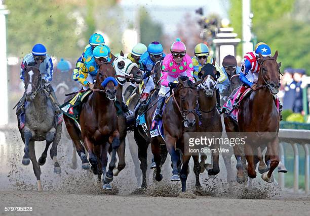 Eventual winner American Pharoah with Jockey Victor Espinoza [left] starts to overtake Firing Line and Dortmund [right] down the finishing stretch at...