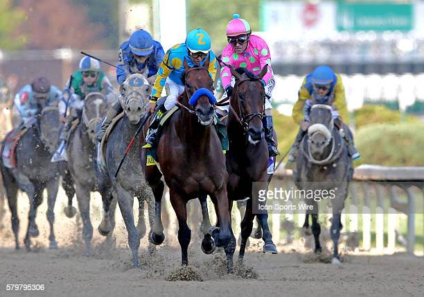 Eventual winner American Pharoah with Jockey Victor Espinoza [center] accelerates down the finishing stretch at the 141st running of the Kentucky...