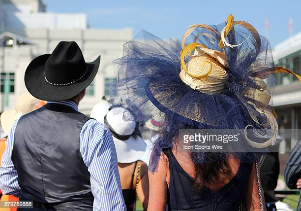 Race fans and fashions at the 141st running of the Kentucky Derby at Churchill Downs in Louisville, Kentucky.