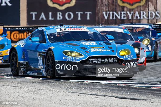 GT Daytona class Aston Martin V12 Vantage with driver team Christina Nielsen and James Davison leads a crowd around Turn 11 during the Continental...