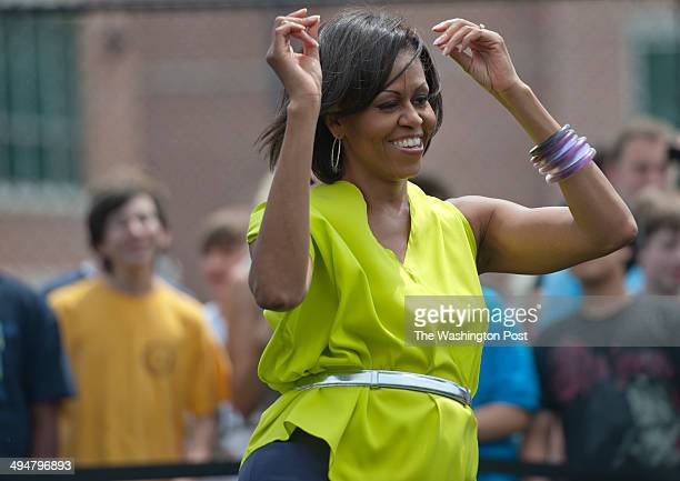 First Lady Michelle Obama greets the students and teachers of Alice Deal Middle School in Tenleytown with a suprise visit where she and the students...