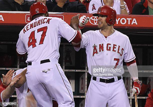 Los Angeles Angels Howie Kendrick gets congratulated by Collin Cowgill during the game against the New York Yankees at Angel Stadium in Anaheim CA