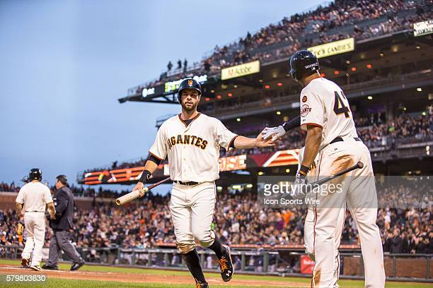 San Francisco Giants first baseman Brandon Belt celebrates scoring with San Francisco Giants right fielder Justin Maxwell in the 3rd inning during...
