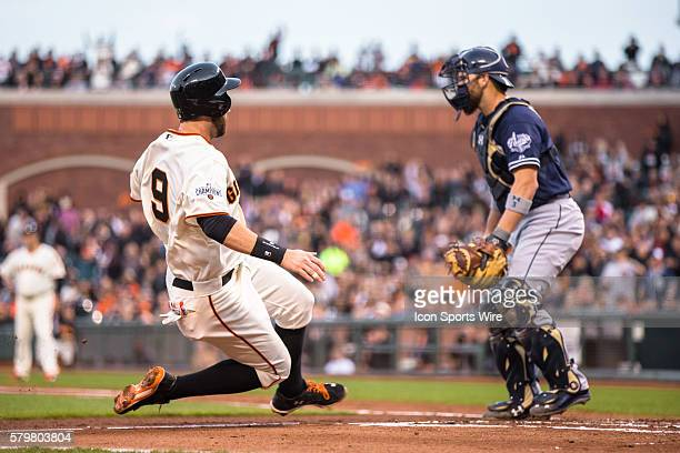 San Francisco Giants first baseman Brandon Belt slides home to score in the 2nd inning off a onerun single bt San Francisco Giants right fielder...