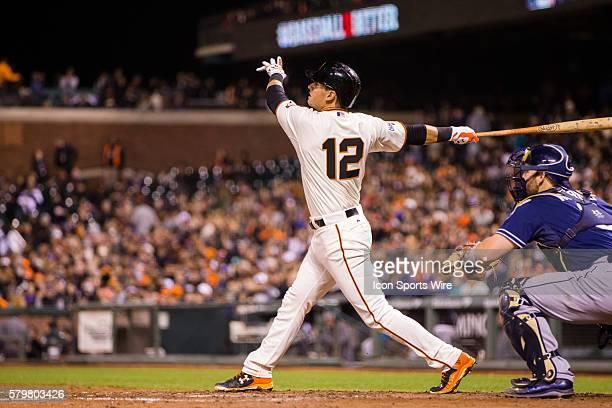 San Francisco Giants second baseman Joe Panik at bat and following the trajectory of the ball during the game between the San Francisco Giants and...