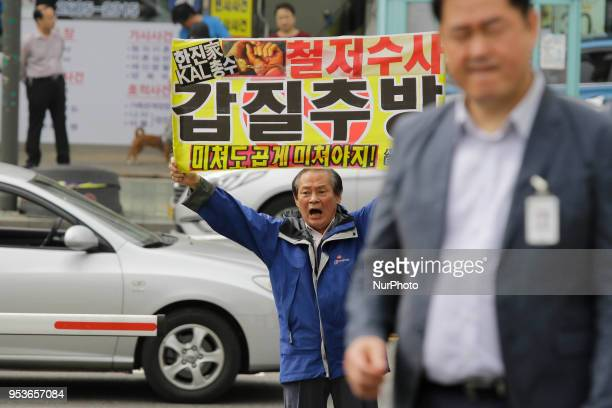 May 1, 2018-Seoul, South Korea-South Korean hold banner with shot slogans during a Cho Hyun Min denounce rally at Seoul Kangseo Police Agency in...