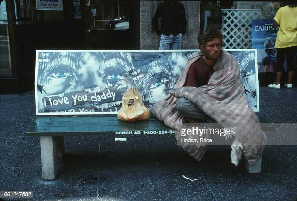 May 1 - Rodney King Riot. View of a dazed young man wrapped in quilt and sitting on bench on Hollywood Boulevard after two nights of fires and...