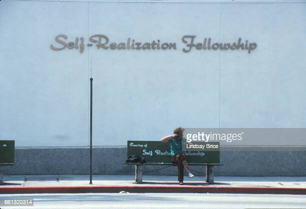 LOS ANGELES May 1 Rodney King Riot View of a disheveled young man sitting on bench at bus stop in front of the SelfRealization Fellowship on Sunset...