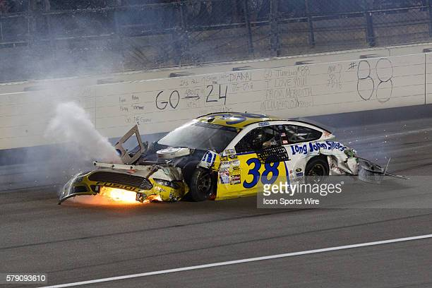 David Gilliland driver of the Long John's Silver's Ford crashes and catches fire near the start finish line during the 4th Annual 5hour Energy 400 at...