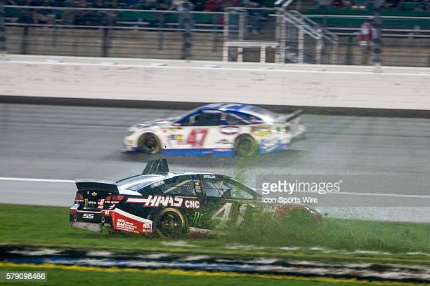 Sprint Cup Series driver Kurt Busch spinning out in the grass during the inaugural night race the 5Hour Energy 400 at the Kansas Speedway in Kansas...