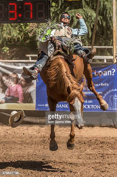 Anthony Thomas fro Kimberley Australia scores 82 points in the bareback bronc riding event at the 58th Annual Mother Lode RoundUp in Sonora...