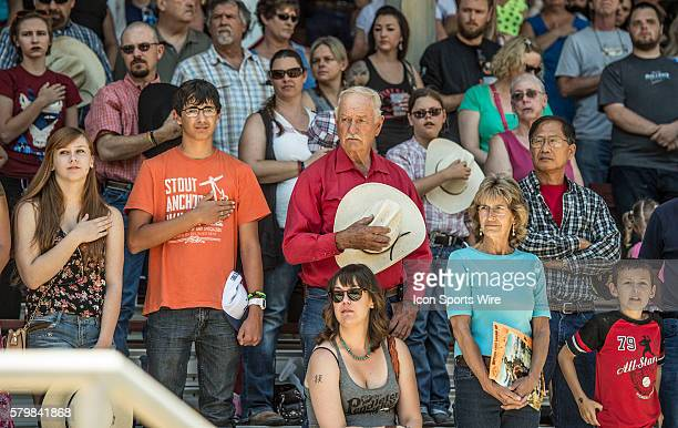 Rodeo crowds during national anthem at the 58th Annual Mother Lode RoundUp in Sonora California on Sunday May 10 2015