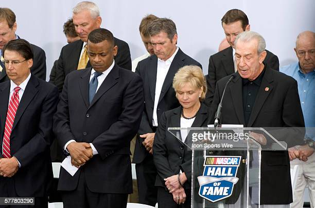 Former NASCAR driver Ned Jarrett leads the invocation next to former Charlotte mayor Pat McCrory far left current Mayor Anthony Foxx and North...