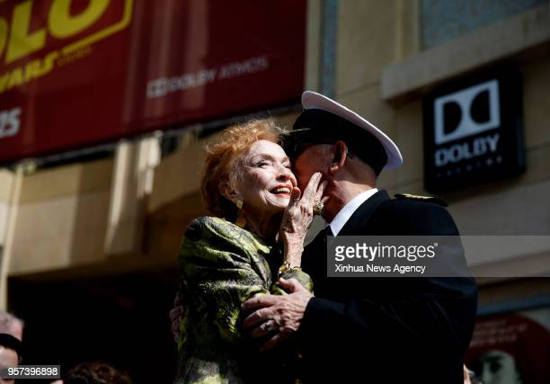 Gavin MacLeod who played the part of Captain Merrill Stubing kisses the creator of The Love Boat Jeraldine Saunders during the star dedication...