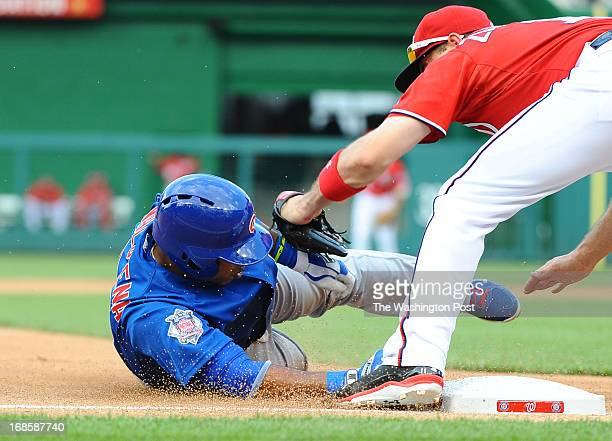 Chicago Cubs third baseman Luis Valbuena is tagged out at third by Washington Nationals Ryan Zimmerman as he attempted to stretch a triple in the 5th...