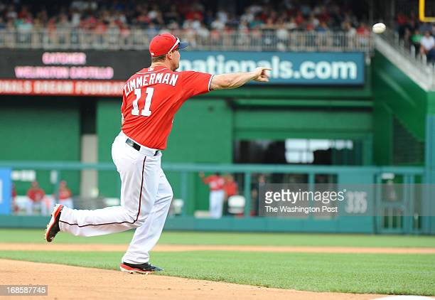 Washington Nationals third baseman Ryan Zimmerman makes a two out throwing error on a grounder by Chicago Cubs catcher Welington Castillo in the 5th...