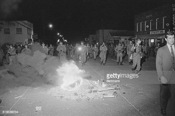 May 12 1967 Jackson Mississippi Hundreds of National Guardsmen with fixed bayonets advance up a riot torn street near Jackson State College to clear...