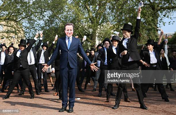 LONDON BRITAIN May 12 Protesters dressed in top hats and a mask of Britain's Prime Minister David Cameron protest against British ownedtax havens...