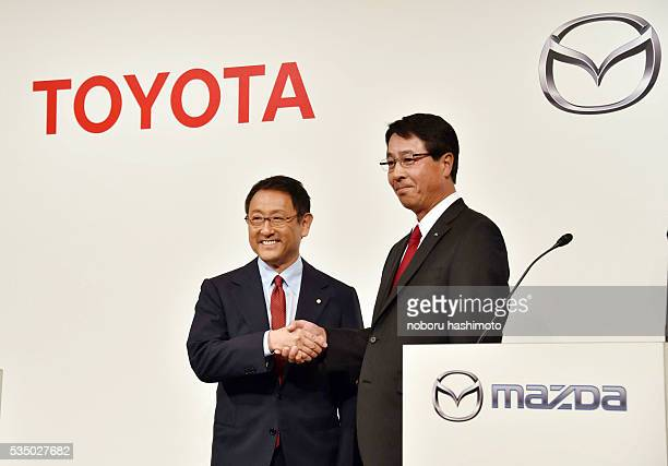 May 13 /2015/Tokyo/Japan Toyota motor Co president Mr Akio Toyota and Mazda Motor corp president Masamichi Kogai shake hands after press conference...