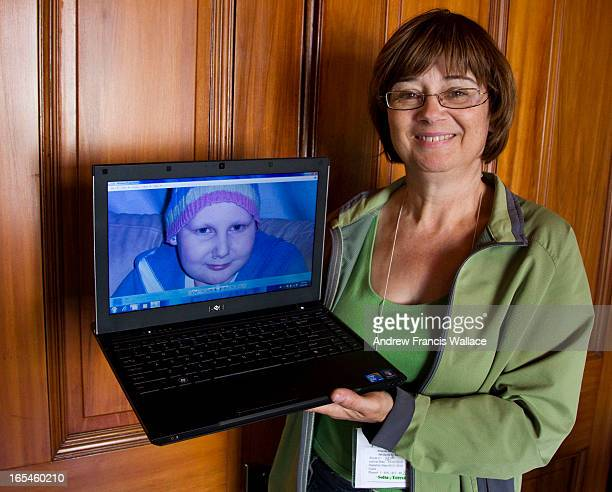 May 14 2010 Teresa Solta hold a new laptop with the recovered photographs of her 17yearold granddaughter Marisa who died in March after a nineyear...