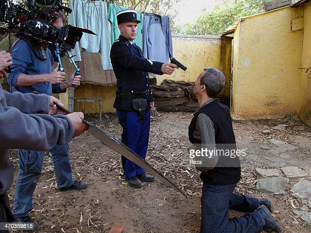 May 14 Oran area Algeria On the set of Zabana a movie by Algerian director Said OuldKhelifa produced by Yacine Laloui A French policeman threatens a...