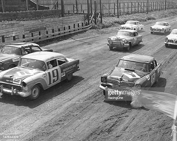 A pair of 1955 Chevrolets lead the way during the NASCAR Cup race at Martinsville Speedway Gordon Smith is driving the No 19 while Speedy Thompson is...