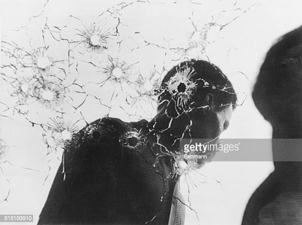 May 16 1970 Jackson Mississippi Unidentified man stands behind shattered window of women's dormitory following the fatal shooting of two Negro...