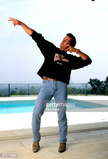May 16, 1991. Sylvester Stallone beside the pool in his Beverly Hills home celebrating the opening of the chain of restaurants called Planet...