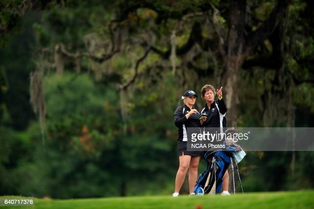 Catlin Bennett of Grand Valley State consults with head coach Lori Stinson during the Division II Women's Golf Championship held at Memorial Park in...