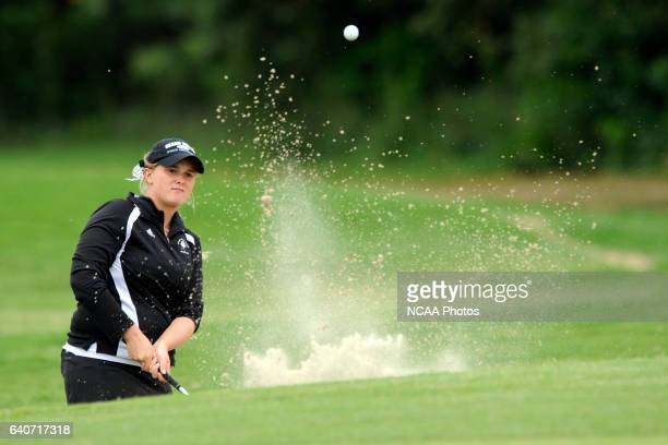 Catlin Bennett of Grand Valley State hits a shot out of the sand trap during the Division II Women's Golf Championship held at Memorial Park in...