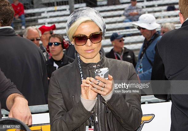 IndyCar Driver Alex Tagliani's wife/model Bronte Tagliani gets in some last minute Tweets during the Qualifications for the 98th running of the...