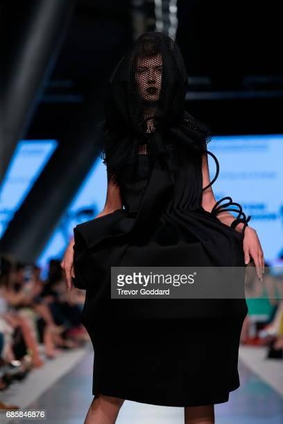 A model walks the runway during Designer Next Generation's show at Arab Fashion Week Ready Couture Resort 2018 held at Meydan in Dubai United Arab...