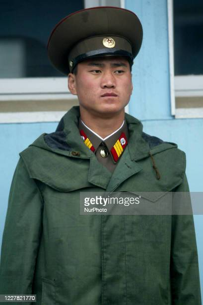 May 18 2005Paju South KoreaNorth Korean soldiers stand guard beside the Military Demarcation Line at the truce village of Panmunjom in the...