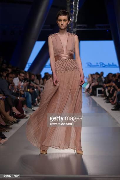 A model walks the runway during Designer Renato Balestra's show at Arab Fashion Week Ready Couture Resort 2018 on May 182017 at Meydan in Dubai...