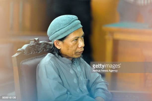 JAKARTA May 18 2018 Indonesian radical cleric Aman Abdurrahman also known as Oman Rohman attends his trial at a district court in Jakarta Indonesia...