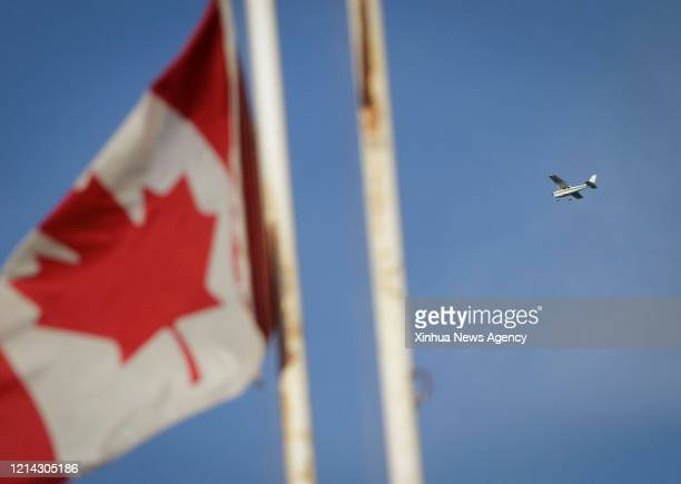 VANCOUVER May 18 2020 An aircraft flies over the sky in honor of the Snowbirds crew member killed in a plane crash in Vancouver Canada May 18 2020 A...