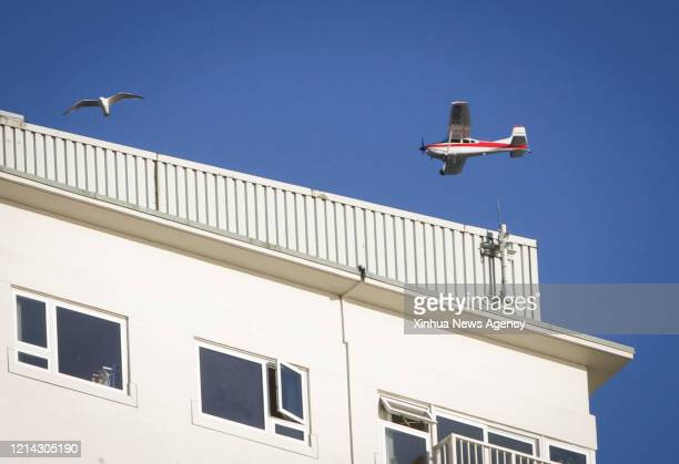 May 18, 2020 -- An aircraft flies over the sky in honor of the Snowbirds crew member killed in a plane crash in Vancouver, Canada, May 18, 2020. A...