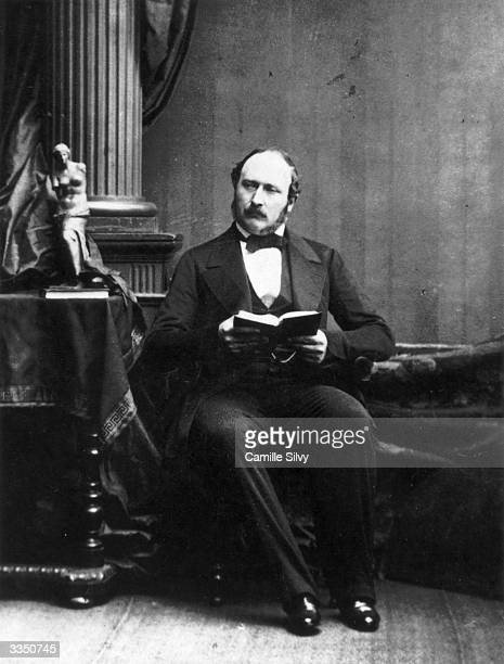 Prince Albert Prince Consort to Queen Victoria reading at Buckingham Palace nineteen months before his death of pneumonia and typhoid