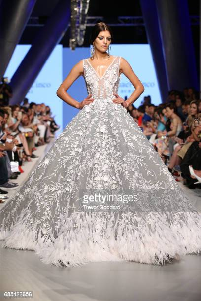 A model walks the runway during Designer Michael Cinco's show at Arab Fashion Week Ready Couture Resort 2018 held at Meydan on May 19 2017 in Dubai...