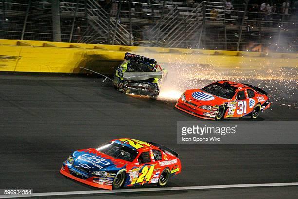 Kyle Busch Hendrick Motorsports Chevrolet Monte Carlo SS crashes as Jeff Burton Richard Childress Racing Chevrolet Monte Carlo SS and Jeff Gordon...